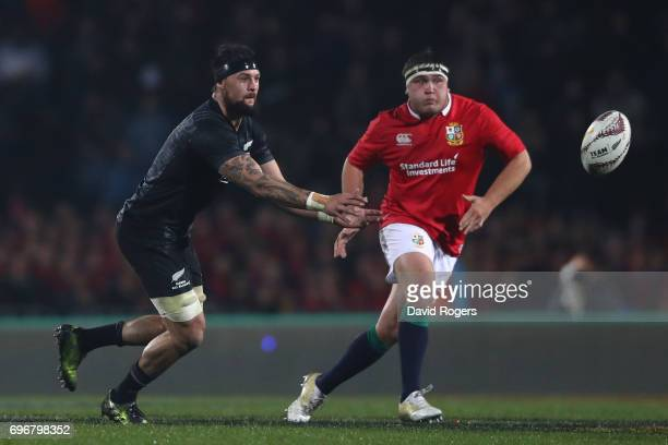 Elliot Dixon of the Maori All Blacks passes the ball as Jamie George of the Lions closes in during the 2017 British Irish Lions tour match between...