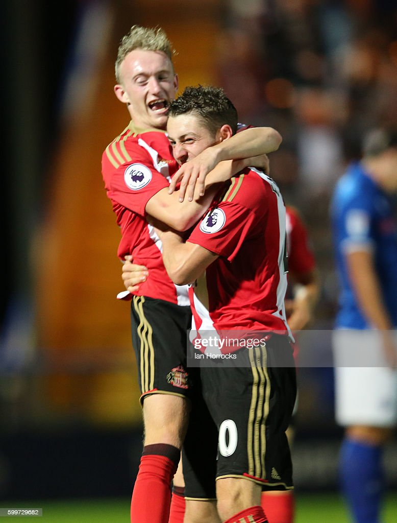 Elliot Embleton of Sunderland (R) celebrates after he scores the opening goal with Rees Greenwood during the U-23 EFL Checkertrade Trophy Group F match between Rochdale and Sunderland U23 at Spotland Stadium on September 6, 2016 in Rochdale, England.