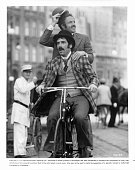 Elliot Gould and Jame Caan are double riding a bicycle in a scene from the film 'Harry And Walter Go To New York' 1976