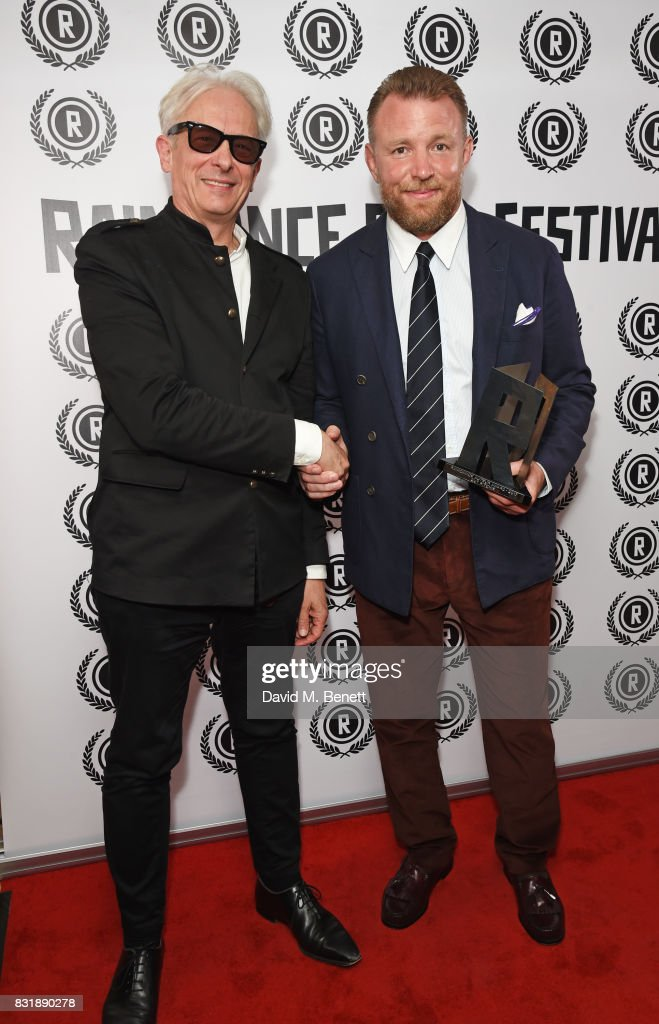 Elliot Grove, founder of the Raindance Film Festival, and Guy Ritchie, winner of the Auteur Award, attend the Raindance Film Festival anniversary drinks reception at The Mayfair Hotel on August 15, 2017 in London, England.