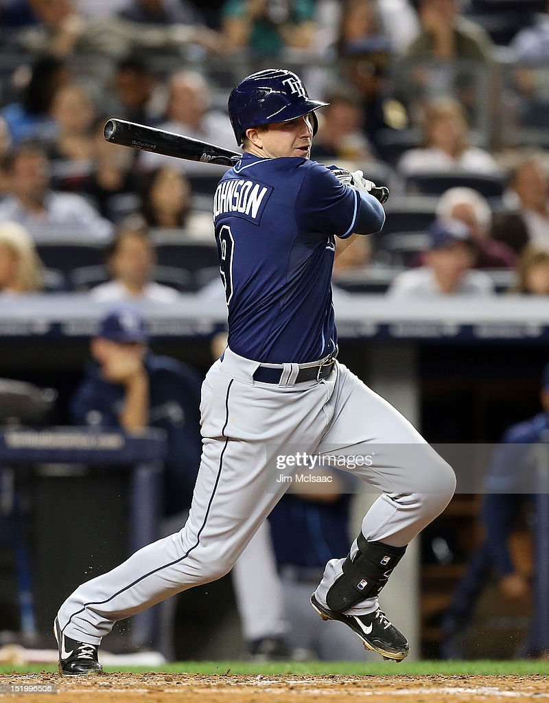 Elliot Johnson #9 of the Tampa Bay Rays follows through on a fifth inning RBI single against the New York Yankees at Yankee Stadium on September 14, 2012 in the Bronx borough of New York City.