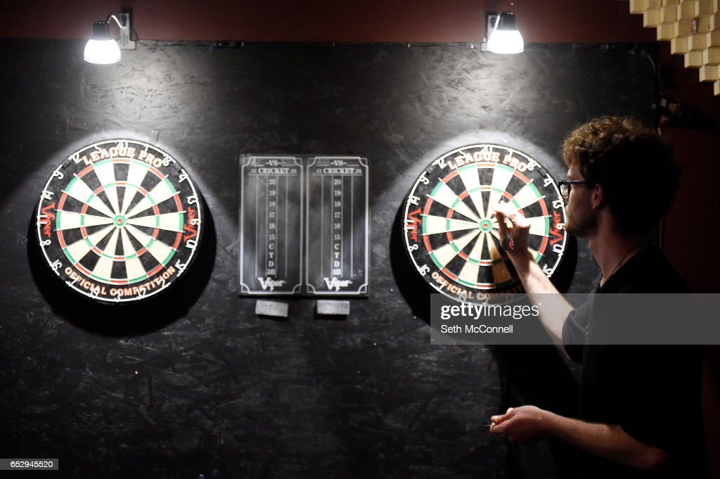Elliot Olbright pulls his darts from a dart board at Your Mom's House on March 9, 2017 in Denver, Colorado. Your Mom's House is Denver's newest concert venue with a full menu of wine and spirits.