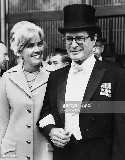 Elliot Richardson US Ambassador to Britain pictured with his wife Anne outside the American Embassy on their way to Buckingham Palace to meet Queen...