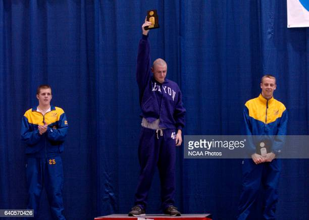 Elliot Rushton of Kenyon receives his first place trophy for the 1650 yard freestyle during the Division 3 Men's Swimming and Diving Championship...