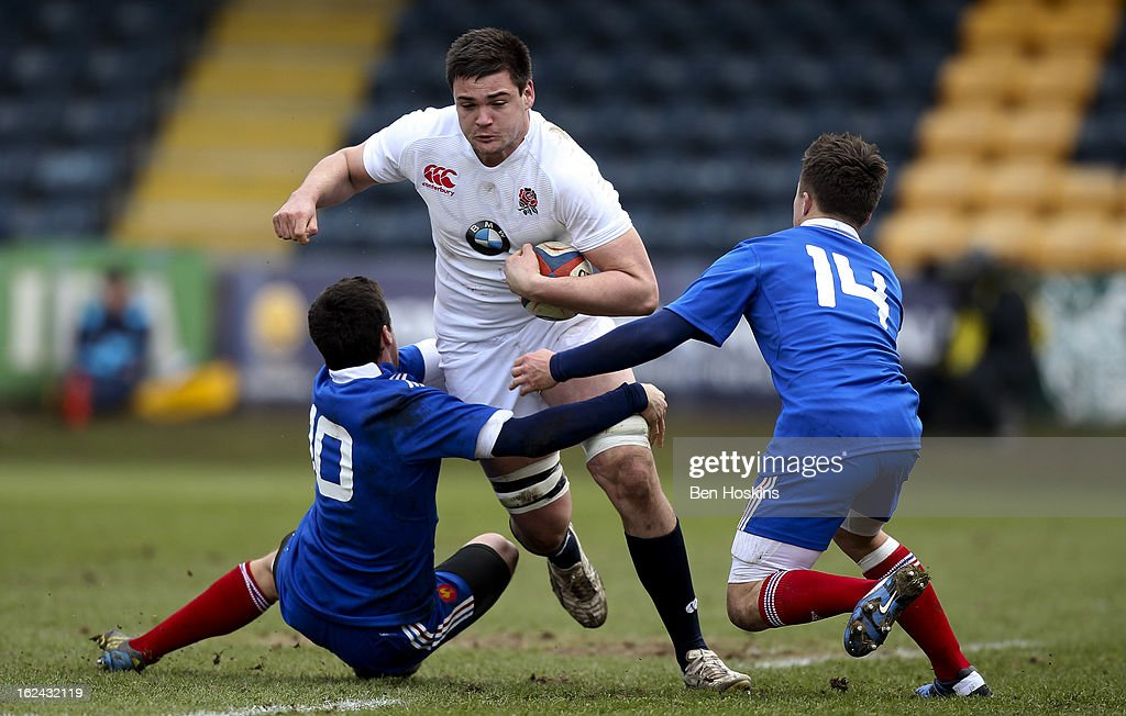 Elliot Stooke of England is tacked by Vincent Mallet (L) and Gabriel Lacroix (R) of France during the U20s RBS Six Nations match between England U20 and France U20 at the Sixways Stadium on February 23, 2013 in Worcester, England.
