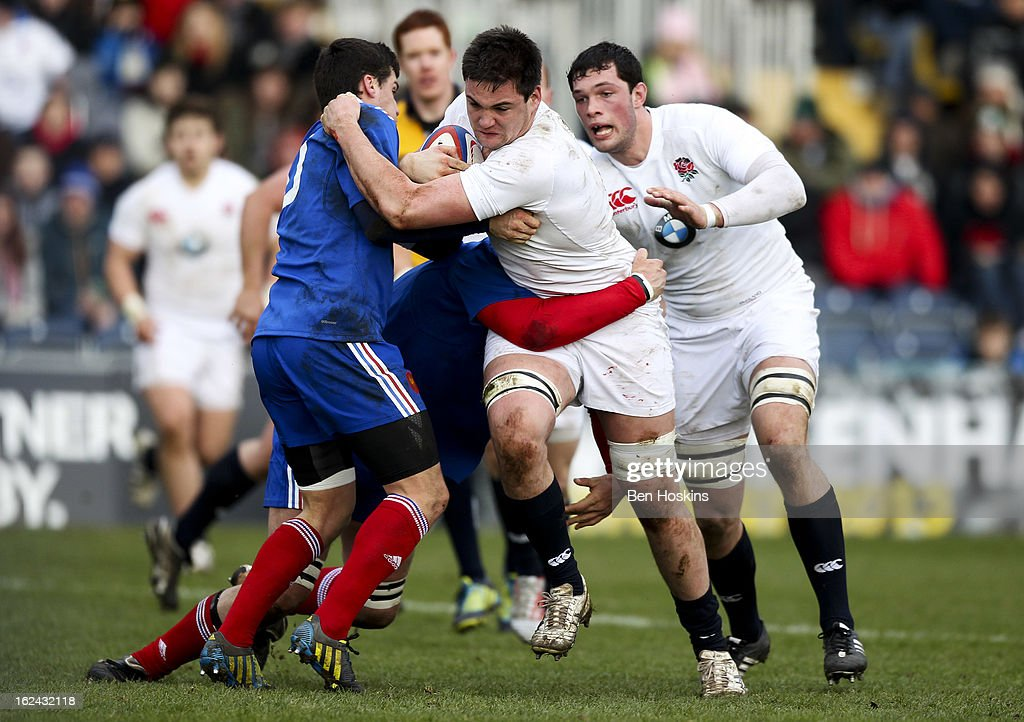 Elliot Stooke of England is tackled by Vincent Mallet of France during the U20s RBS Six Nations match between England U20 and France U20 at the Sixways Stadium on February 23, 2013 in Worcester, England.