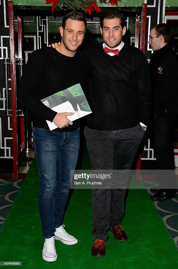 Elliot Wright and James 'Arg' Argent attends the press night for 'Wicked' at Apollo Victoria Theatre on December 19, 2013 in London, England.