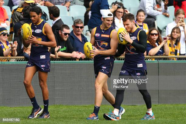 Elliot Yeo and Luke Shuey share a moment while walking laps during a West Coast Eagles AFL training session at Domain Stadium on September 11 2017 in...