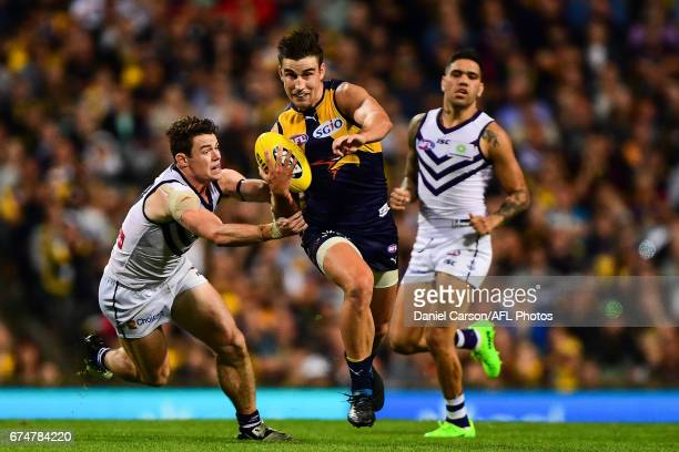 Elliot Yeo of the Eagles breaks past a tackle from Lachie Neale of the Dockers during the 2017 AFL round 06 match between the West Coast Eagles and...
