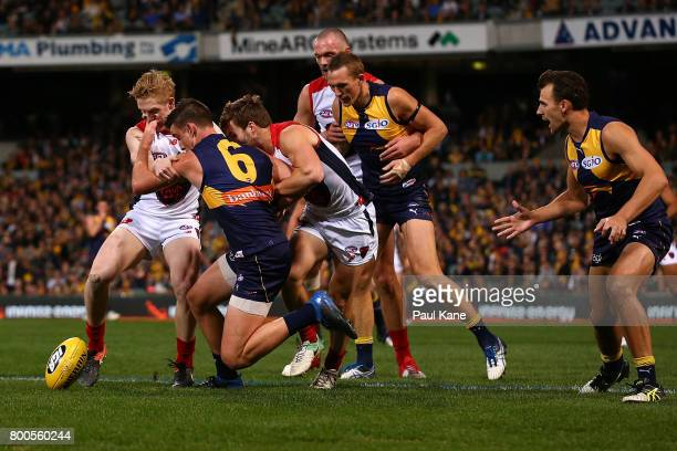 Elliot Yeo of the Eagles contest for the ball during the round 14 AFL match between the West Coast Eagles and the Melbourne Demons at Domain Stadium...