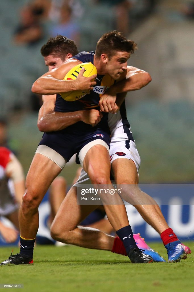 Elliot Yeo of the Eagles gets gets tackled by Jesse Hogan of the Demons during the JLT Community Series AFL match between the West Coast Eagles and the Melbourne Demons at Domain Stadium on March 9, 2017 in Perth, Australia.