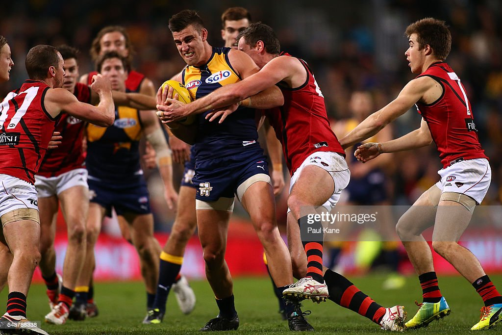 Elliot Yeo of the Eagles gets tackled by <a gi-track='captionPersonalityLinkClicked' href=/galleries/search?phrase=Matthew+Leuenberger&family=editorial&specificpeople=681860 ng-click='$event.stopPropagation()'>Matthew Leuenberger</a> of the Bombers during the round 15 AFL match between the West Coast Eagles and the Essendon Bombers at Domain Stadium on June 30, 2016 in Perth, Australia.