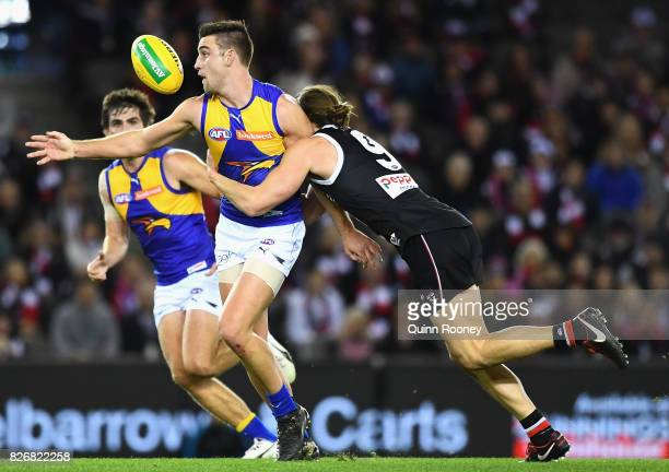 Elliot Yeo of the Eagles is tackled by Jack Steele of the Saints during the round 20 AFL match between the St Kilda Saints and the West Coast Eagles...