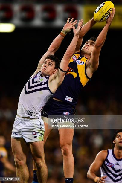 Elliot Yeo of the Eagles takes a mark over Lachie Neale of the Dockers during the 2017 AFL round 06 match between the West Coast Eagles and the...