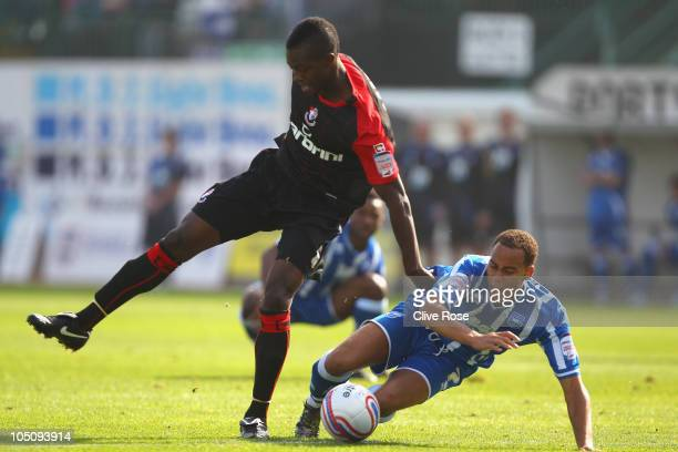 Elliott Bennett of Brighton Hove Albion is challenged by Marvin Bartley of Bournemouth during the npower League One match between Brighton Hove...