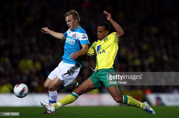 Elliott Bennett of Norwich battles with Sebastian Larsson of Sunderland during the Barclay's premier league match between Norwich and Sunderland at...
