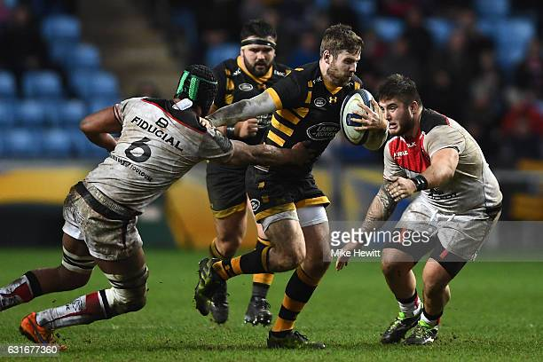 Elliott Daly of Wasps breaks through the tackle of Thierry Dusautoir of Toulouse on his way to scoring a solo try during the European Rugby Champions...