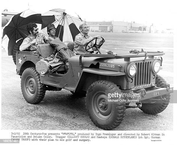 Elliott Gould and Donald Sutherland are driven in jeep by Bobby Troup in a scene from the film 'MASH' 1970