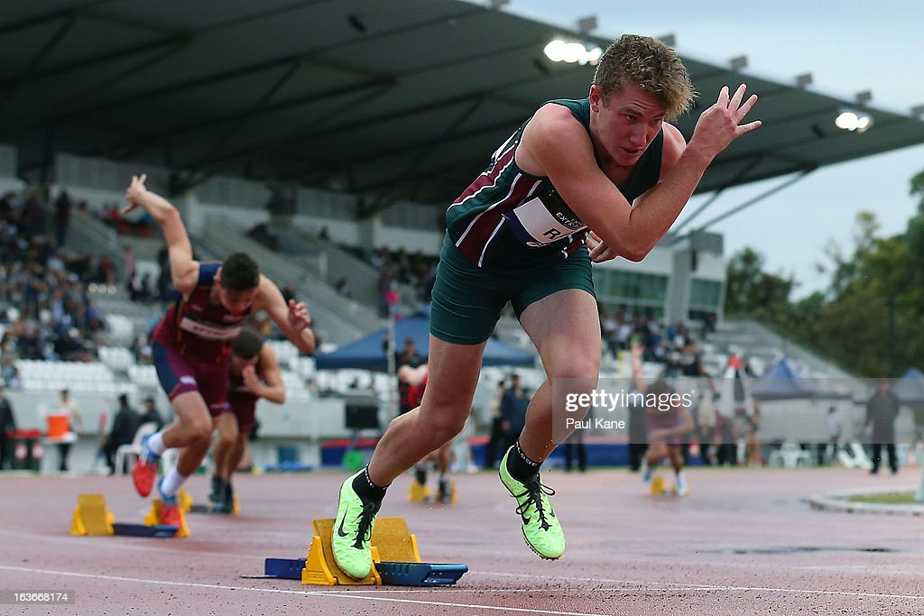Elliott Rae of Tasmania competes in the men's u17 400 metre hurdles final during day three of the Australian Junior Championships at the WA Athletics Stadium on March 14, 2013 in Perth, Australia.