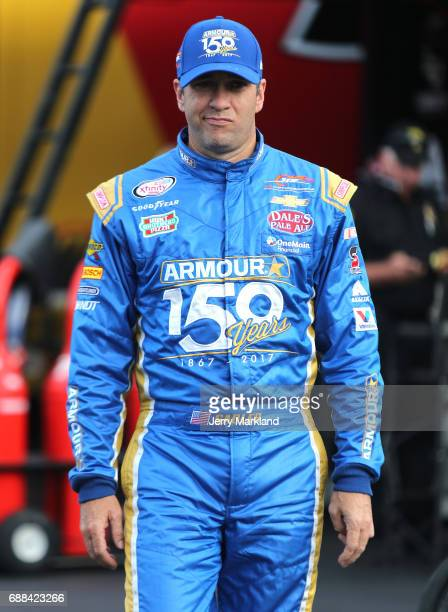 Elliott Sadler driver of the Armour Vienna Sausage 150 Years Chevrolet walks to his car during practice for the NASCAR Xfinity Series Hisense 4K TV...