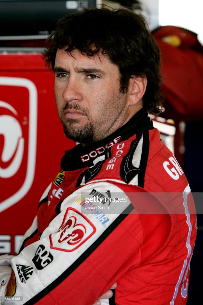 Elliott Sadler driver of the Dodge Dealers/UAW Dodge stands in the garage area during practice for the NASCAR Nextel Cup Series Subway Fresh Fit 500...
