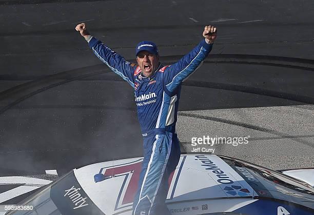 Elliott Sadler driver of the OneMain Chevrolet celebrates after winning the NASCAR XFINITY Series VFW Sport Clips Help a Hero 200 at Darlington...