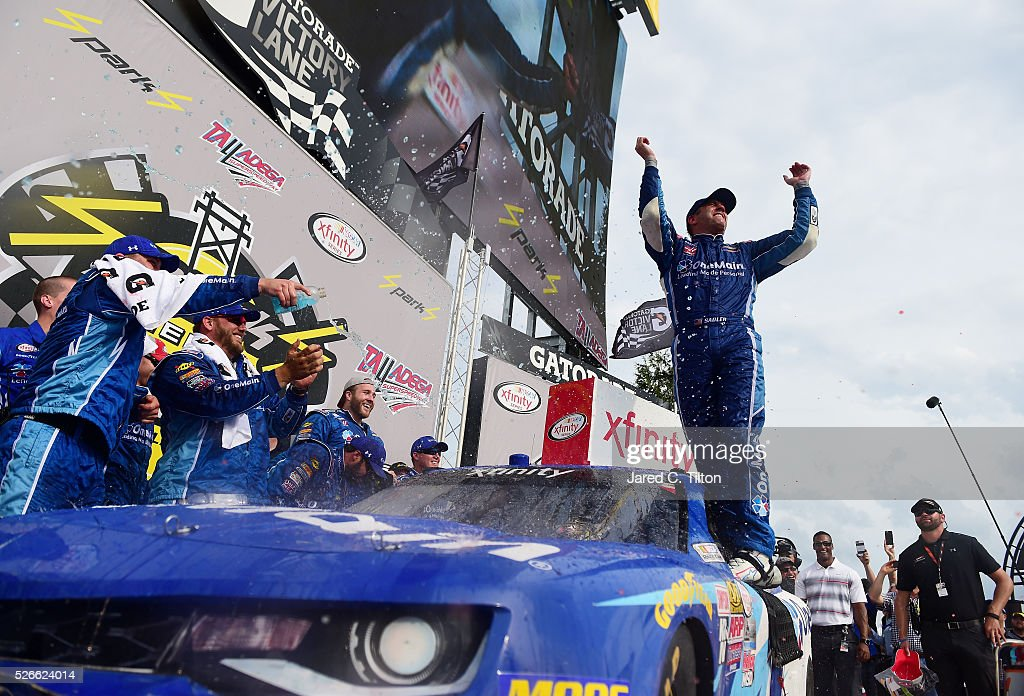 sadler driver of the 1 onemain chevrolet celebrates in victory lane. Cars Review. Best American Auto & Cars Review