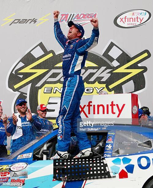 Elliott Sadler driver of the OneMain Chevrolet celebrates in Victory Lane after winning the NASCAR XFINITY Series Sparks Energy 300 at Talladega...