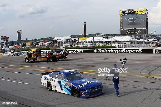 Elliott Sadler driver of the OneMain Chevrolet celebrates winning the NASCAR XFINITY Series Sparks Energy 300 at Talladega Superspeedway on April 30...