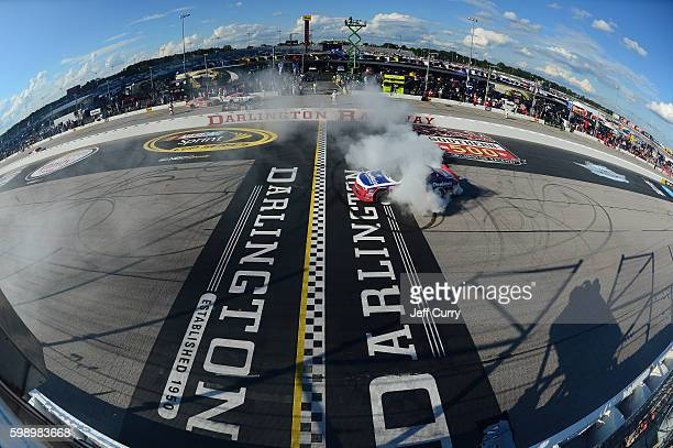Elliott Sadler driver of the OneMain Chevrolet does a burnout after winning the NASCAR XFINITY Series VFW Sport Clips Help a Hero 200 at Darlington...