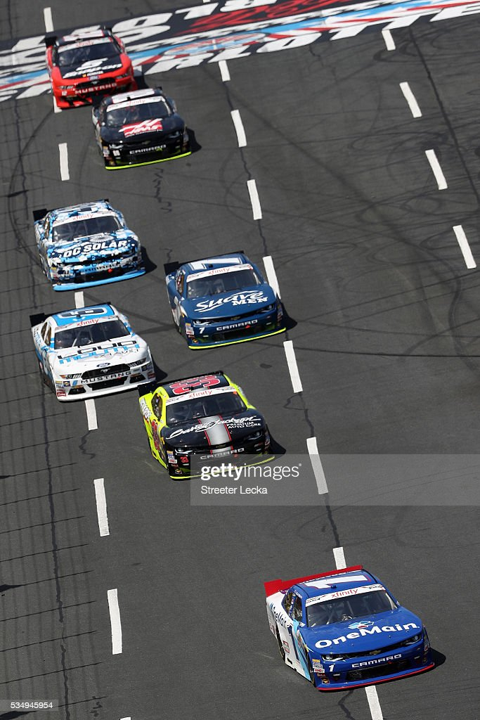 <a gi-track='captionPersonalityLinkClicked' href=/galleries/search?phrase=Elliott+Sadler&family=editorial&specificpeople=204623 ng-click='$event.stopPropagation()'>Elliott Sadler</a>, driver of the #1 OneMain Chevrolet, leads a pack of cars during the NASCAR XFINITY Series Hisense 300 at Charlotte Motor Speedway on May 28, 2016 in Charlotte, North Carolina.