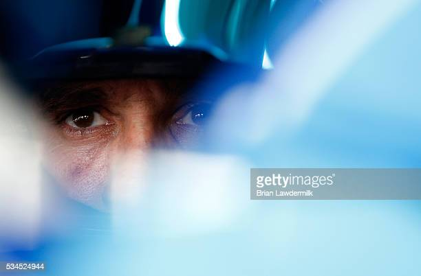 Elliott Sadler driver of the OneMain Chevrolet sits in his car during practice for the NASCAR XFINITY Series Hisense 4K TV 300 at Charlotte Motor...
