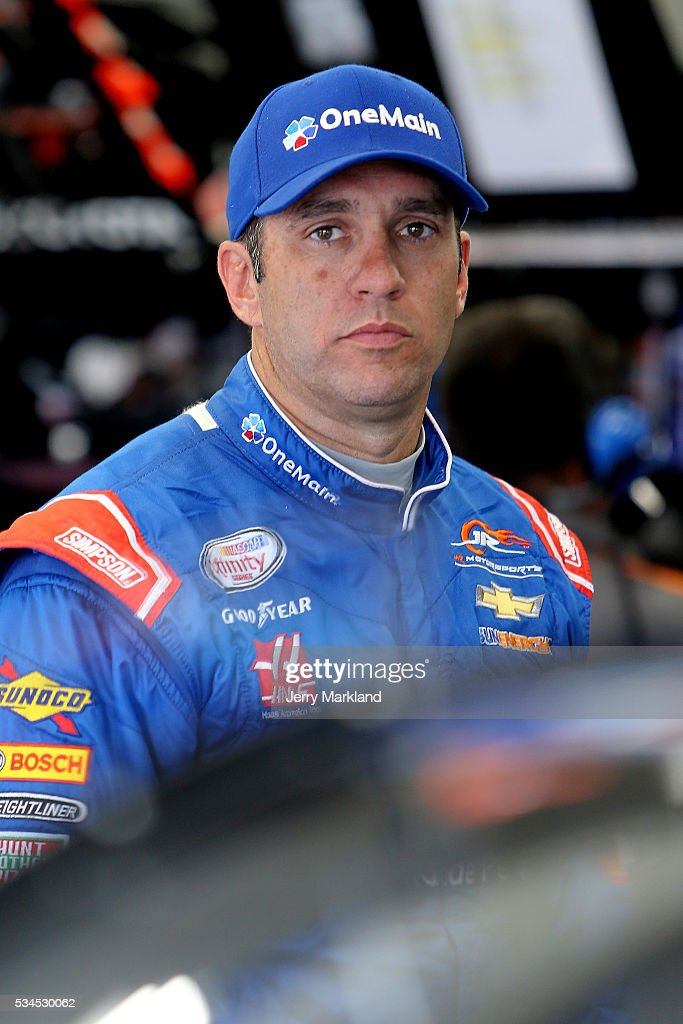 <a gi-track='captionPersonalityLinkClicked' href=/galleries/search?phrase=Elliott+Sadler&family=editorial&specificpeople=204623 ng-click='$event.stopPropagation()'>Elliott Sadler</a>, driver of the #1 OneMain Chevrolet, stands in the garage area during practice for the NASCAR XFINITY Series Hisense 4K TV 300 at Charlotte Motor Speedway on May 27, 2016 in Charlotte, North Carolina.