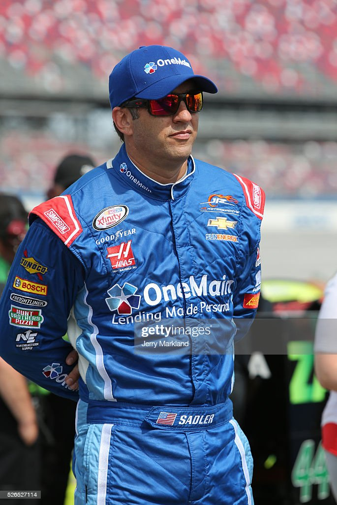 Elliott Sadler, driver of the #1 OneMain Chevrolet, stands on the grid during qualifying for the NASCAR XFINITY Series Sparks Energy 300 at Talladega Superspeedway on April 30, 2016 in Talladega, Alabama.