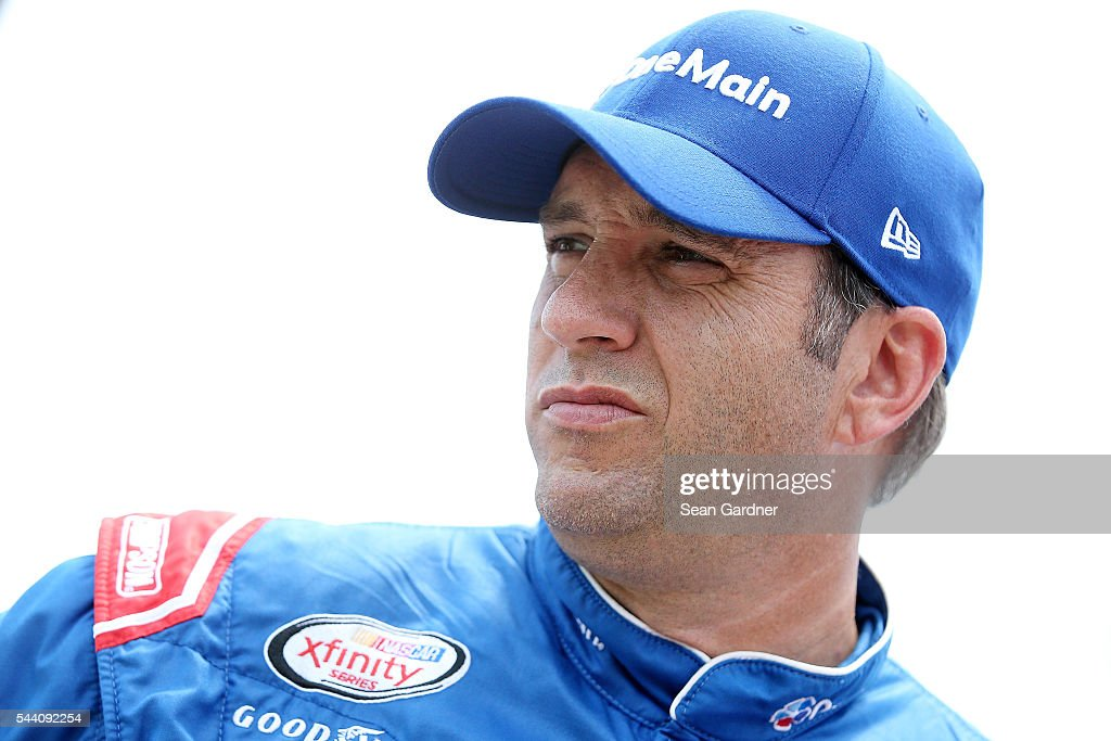 <a gi-track='captionPersonalityLinkClicked' href=/galleries/search?phrase=Elliott+Sadler&family=editorial&specificpeople=204623 ng-click='$event.stopPropagation()'>Elliott Sadler</a>, driver of the #1 OneMain Chevrolet, stands on the grid during qualifying for the NASCAR XFINITY Series Subway Firecracker 250 at Daytona International Speedway on July 1, 2016 in Daytona Beach, Florida.