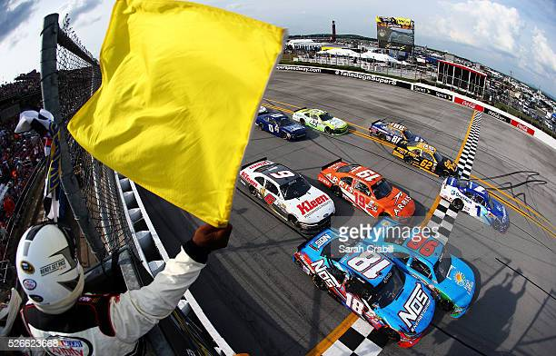Elliott Sadler driver of the OneMain Chevrolet takes the checkered flag to win after the field was frozen due to caution on the final lap of the...