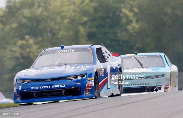 Elliott Sadler driver of the OneMain Financial Chevrolet and Daniel Hemric driver of the Blue Gate Bank Chevrolet practice for the NASCAR XFINITY...