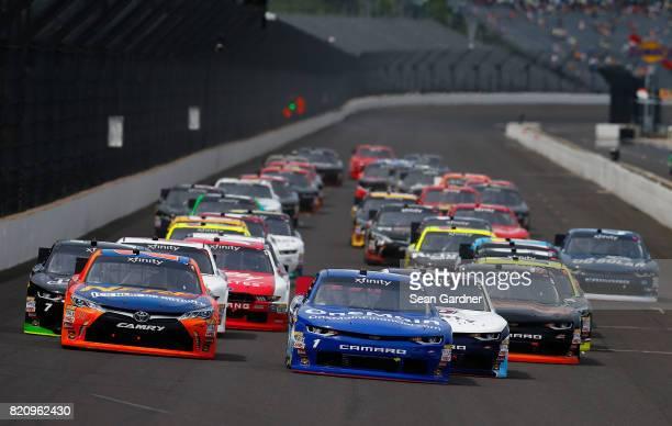 Elliott Sadler driver of the OneMain Financial Chevrolet and Erik Jones driver of the GameStop/Nerf Toyota take the green flag to start the NASCAR...