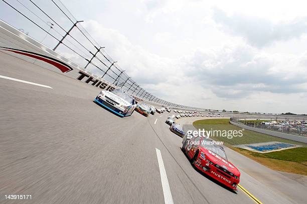 Elliott Sadler driver of the OneMain Financial Chevrolet and Ricky Stenhouse Jr driver of the Blackwell Angus Beef/Cargill Ford follow the pace car...