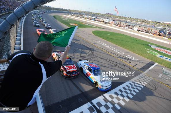 Elliott Sadler driver of the OneMain Financial Chevrolet and Trevor Bayne driver of the 3M Ford lead the field to the green flag to start the NASCAR...
