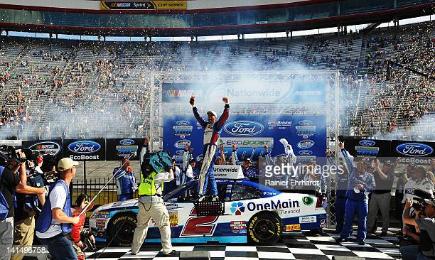 Elliott Sadler driver of the OneMain Financial Chevrolet celebrates in Victory Lane after winning the NASCAR Nationwide Series Ford EcoBoost 300 at...