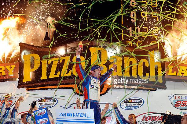 Elliott Sadler driver of the OneMain Financial Chevrolet celebrates in victory lane after winning the US Cellular 250 race at Iowa Speedway on August...