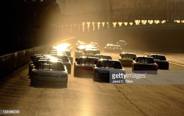 Elliott Sadler driver of the OneMain Financial Chevrolet leads a group of cars during the NASCAR Nationwide Series Ford 300 at HomesteadMiami...