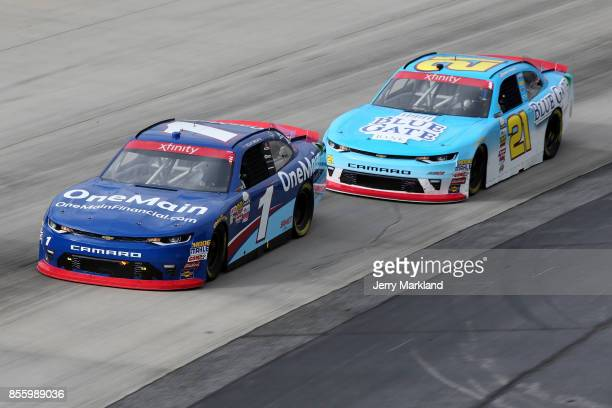 Elliott Sadler driver of the OneMain Financial Chevrolet leads Daniel Hemric driver of the Blue Gate Bank Chevrolet during the NASCAR XFINITY Series...