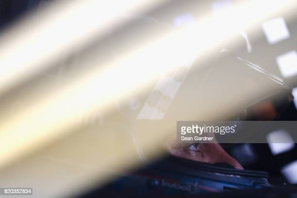 Elliott Sadler driver of the OneMain Financial Chevrolet sits in his car during practice for the NASCAR XFINITY Series Lilly Diabetes 250 at...