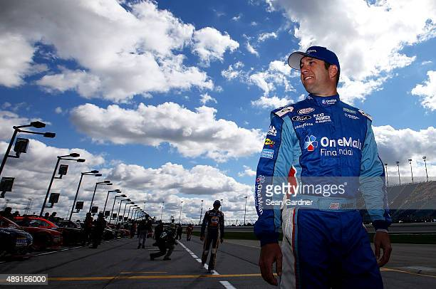 Elliott Sadler driver of the OneMain Financial Ford walks on the grid during qualifying for the NASCAR XFINITY Series FURIOUS 7 300 at Chicagoland...