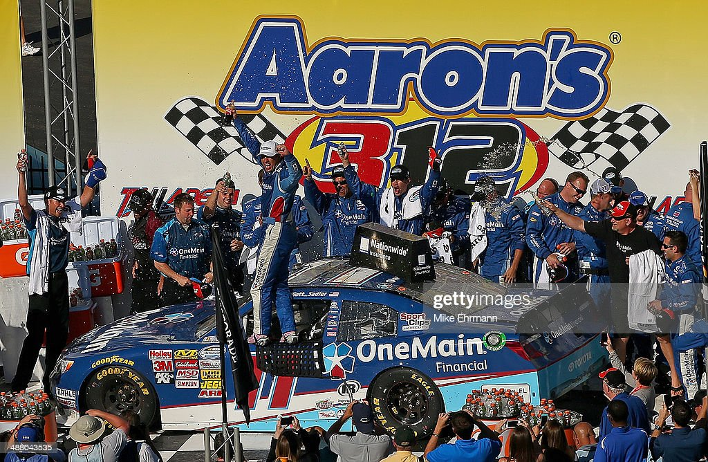 Elliott Sadler, driver of the #11 OneMain Financial Toyota, celebrates in Victory Lane after winning the NASCAR Nationwide Series Aaron's 312 at Talladega Superspeedway on May 3, 2014 in Talladega, Alabama.