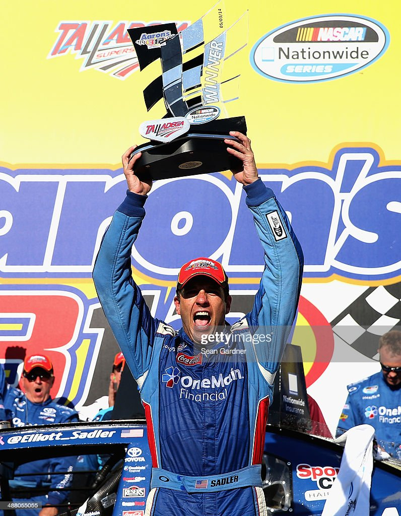 Elliott Sadler, driver of the #11 OneMain Financial Toyota, celebrates in Victory Lane with the trophy after winning the NASCAR Nationwide Series Aaron's 312 at Talladega Superspeedway on May 3, 2014 in Talladega, Alabama.