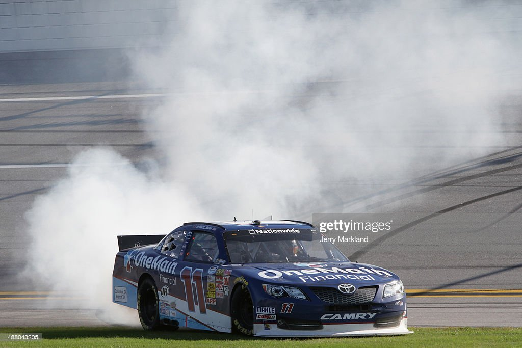 Elliott Sadler, driver of the #11 OneMain Financial Toyota, celebrates with a burnout after winning the NASCAR Nationwide Series Aaron's 312 at Talladega Superspeedway on May 3, 2014 in Talladega, Alabama.