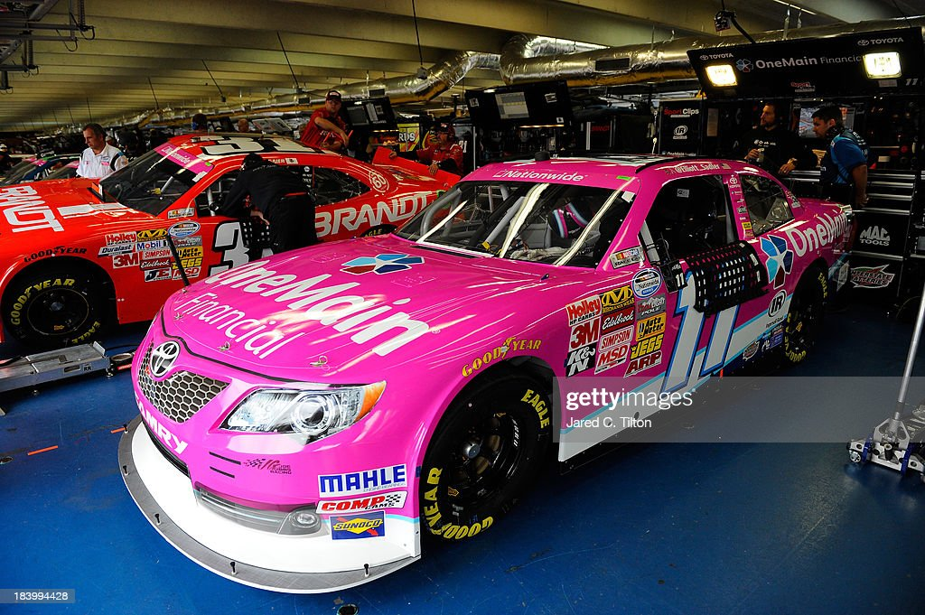 <a gi-track='captionPersonalityLinkClicked' href=/galleries/search?phrase=Elliott+Sadler&family=editorial&specificpeople=204623 ng-click='$event.stopPropagation()'>Elliott Sadler</a>, driver of the #11 OneMain Financial Toyota, during practice for the NASCAR Nationwide Series Dollar General 300 at Charlotte Motor Speedway on October 10, 2013 in Concord, North Carolina.